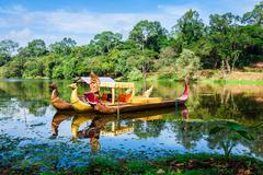 Thai traditional  boats on the lake near,Bayon temple in Angkor Thom, Siemrea - stock photo