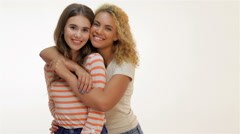 Two laughing girls hugging Stock Footage