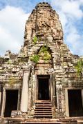 Faces of ancient Bayon Temple At Angkor Wat, Siem Reap, Cambodia - stock photo