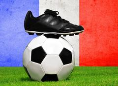 Soccer ball and cleats in grass Stock Photos