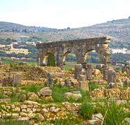 volubilis in morocco africa the old roman deteriorated monument - stock photo