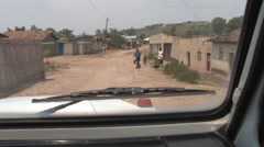 Driving a Car Through a Poor African Village in Rwanda - stock footage