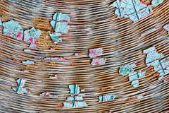 pieces of colour debris laid on wicker background - stock photo