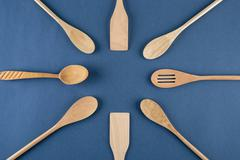 Stock Photo of wooden spoons on a blue