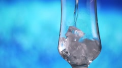 Water pouring into glass with ice slow motion fresh natural cool with bubbles. Stock Footage