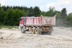 Freight trucks with dump body - stock photo