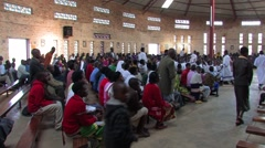 People in the African Village are Gathering in the Church at Beginning of Mass Stock Footage