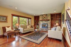 Traditional living room with hardwood floor. - stock photo
