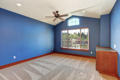 Large unfurnished room with blue interior. Stock Photos