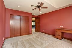 Big unfurnished room with red interior. Stock Photos