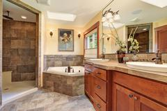 Lovely master bathroom with stone floor. - stock photo