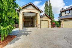 Luxurious home with large driveway. - stock photo
