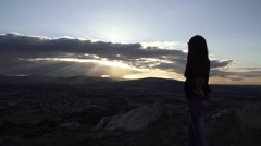 Girl looking over the irish countryside at sunset Stock Footage