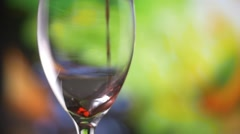Red wine poured into wine glass highspeed slow motion - stock footage