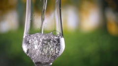 Water pouring into glass slow motion fresh natural cool with bubbles. Stock Footage