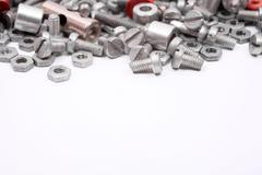 Bolts and Nuts isolated on white background - stock photo