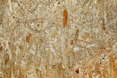 Yellow wood chipboard as background Stock Photos