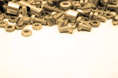 Sepia bolts and nuts isolated on white background Stock Photos