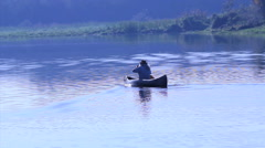 Man in a boat rowing. Beautiful river. Brazilian forest. Stock Footage