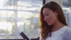 4K Attractive woman on her phone on her train journey, shot on RED EPIC Stock Footage