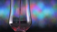 Soft drink soda pour into glass slowmotion on colorful background Stock Footage