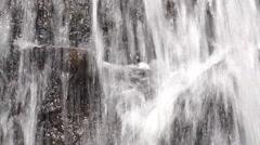 Rocks being splashed by waterfall water crashing down 4k - stock footage