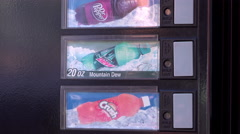 Buying Mountain Dew drink from soda machine 4k Stock Footage