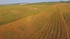AERIAL VIEW.  The mechanical harvester harvests crops Stock Footage