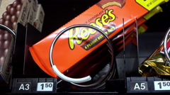 Peanut Butter cups being purchased from vending machine 4k Stock Footage