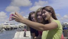 Friends Take Fun Photos Together On A Dock (Slow Motion) Stock Footage