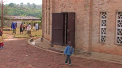 People in African Village are Gathering in Front of Church at Beginning of Mass Stock Footage