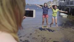 Teen Takes A Photo Of Friends Jumping In The Air On The Beach On Nantucket Stock Footage