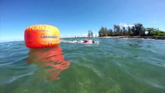 Salmini 10011-080815 - Swimmer around buoy and camera goes underwater Stock Footage