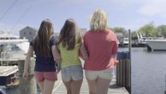 Preppy Teen Girls Walk Arm In Arm Down Dock In Nantucket Marina (4K) Stock Footage