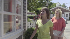 Funny Teens Pose Like Mannequins In Front Of Store On Nantucket (4K) Stock Footage