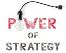 Power of strategy phrase and light bulb, hand writing, Marketing Business Stock Photos