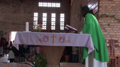 Priest Preaches in a Full African Church in a Small Rural Village - stock footage