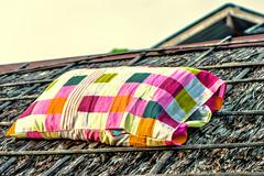 Bright color isolated checked sack on old roof Stock Photos
