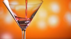 Cocktail Soft drink soda pour into glass slowmotion on colorful background Stock Footage