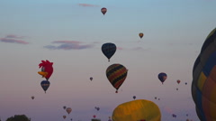 Flying hot air balloons 42 - Many++ balloons in sky, woody wood pecker - evening Stock Footage