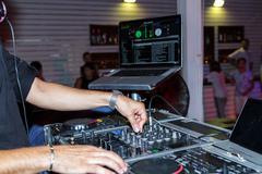 Dj hands on equipment deck . - stock photo
