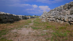 Ruined by time of walls of the ancient city. Low angle shot. Stock Footage