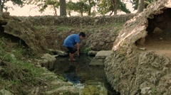 Boy Wades in Spring Water Stock Footage