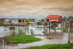 Homes on stilts on the floating village of Kampong Phluk, Tonle Sap lake,Siem - stock photo