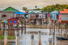 Stock Photo of Homes on stilts on the floating village of Kampong Phluk, Tonle Sap lake,Siem