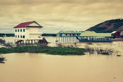 Stock Photo of The village on the water. Tonle sap lake. Cambodia