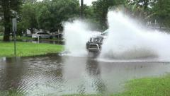 Big Splash Pickup Truck Drives Thru Flooded Neighborhood Street Stock Footage