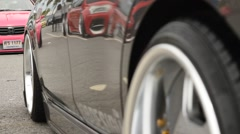Car showing process of Air suspension,  Rack focus Stock Footage