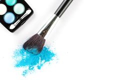 blue Powder Eyeshadow on a Brush with Make up Palette - stock photo