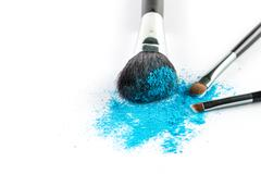 blue Powder Eyeshadow on a Brush, fashion beauty - stock photo